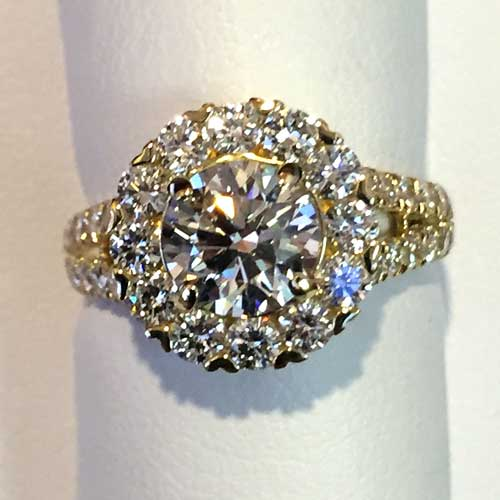 diamond ring with diamond encrusted circle